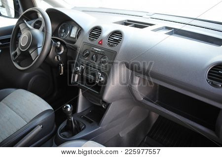 Interior Of A Modern Car With Six Gear Lever And Steering Wheel. Prestigious Salon Of The Minivan