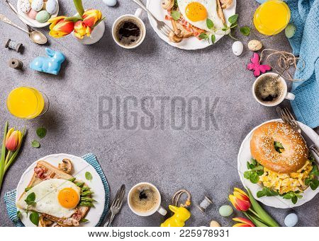 Easter Breakfast Flat Lay With Scrambled Eggs Bagels, Orange Tulips, Bread Toast With Fried Egg And
