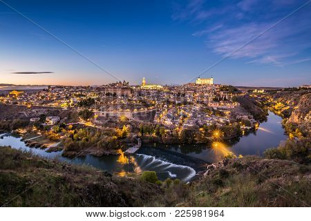 Toledo Cityscape With Alcazar At Dusk In Madrid Spain
