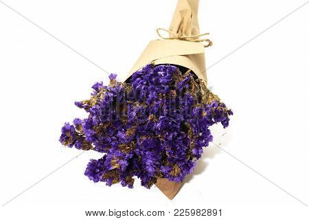 Close Up Of Bouquet Violet Statice Dry Flower On White Background