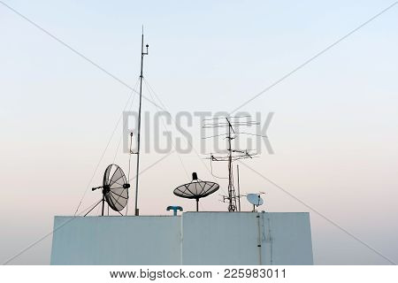 Satellite Dishes And Tv Antennas  On Skyscraper In Bangkok In The Morning