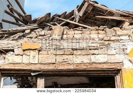 Small Old And Abandoned House Roof Demolished By The Earthquake Destruction Closeup