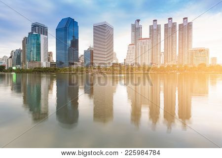City Office Building With Water Reflection In Public Park, Cityscape Background