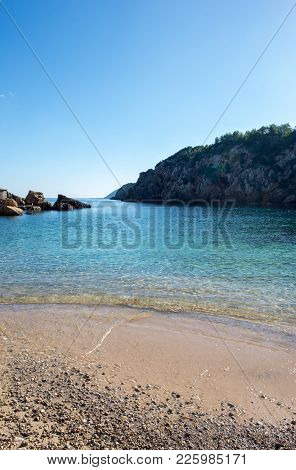 The Cove Will Be With Blue Water On The Island Of Ibiza