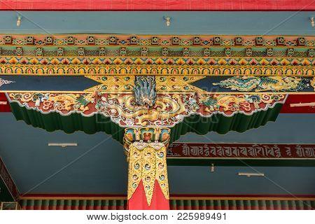 Coorg, India - October 29, 2013: Gold Decorated Pilar And Beams Supporting Mandapam At Padmasambhava