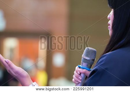 Smart Businesswoman Speech Or Speaking With Microphone In Seminar Hall, Hand Gesturing Protesting Or
