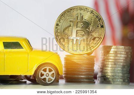 Finance Investment Risk Internet Concept: Miniature Yellow Miniature Car Near Bitcoin Digital Virtua
