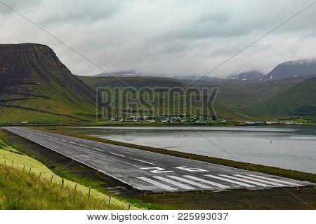 Airport, Runway And City Of Isafjordur On The Wesfjords In Nothern Iceland