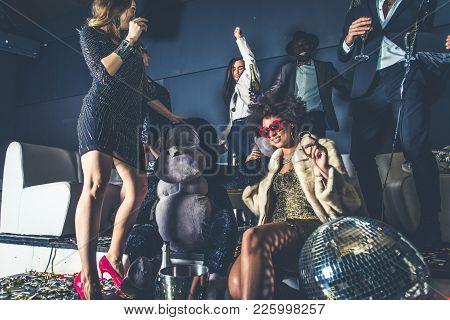 Friends Having Party In A Nightclub