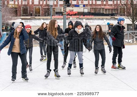 Stockholm, Sweden - February 3, 2018: Front View Of Several Happy Young Woman Skating At A Public Ic
