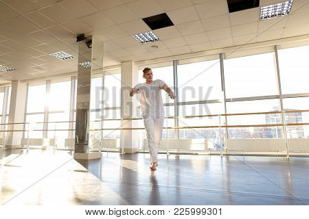 Hip-hop Dancer Rehearse Before Performance On Charity Event, Tattooed Male Moving Energetically. Fai