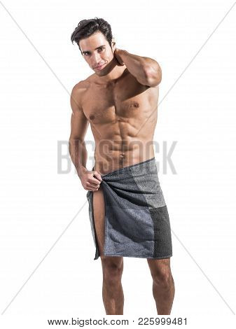 Portrait Of Naked Handsome Young Man With Languishing Look Covering Crotch With A Towel, Isolated On