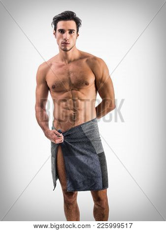 Portrait Of Naked Handsome Young Man With Languishing Look Covering Crotch With A Towel