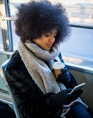 Beautiful woman driving on a bus - Afroamerican girl portrait outdoors poster