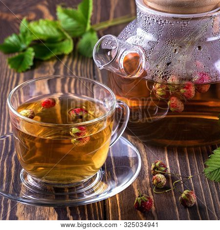Strawberry Tea On Rustic Wooden Table Stock Photo