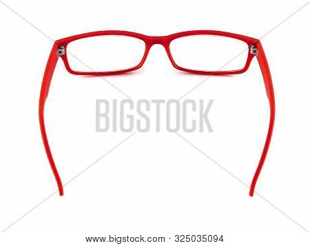 Red Plastic Glasses To Correct Poor Vision. Glasses Red On White Background