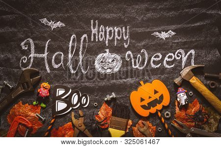 Happy Halloween Day With Construction Diy Handy Tools On Black Chalk Board Background Concept. Flat