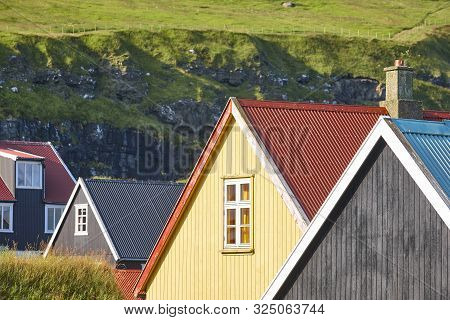 Traditional Feroe Islands Village With Colored Rooftops And Green Hills