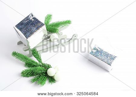 Glittery Paper Gifts Boxs. Christmas Sleigh With Gifts. New Years Minimal Concept. Decorative Toys I