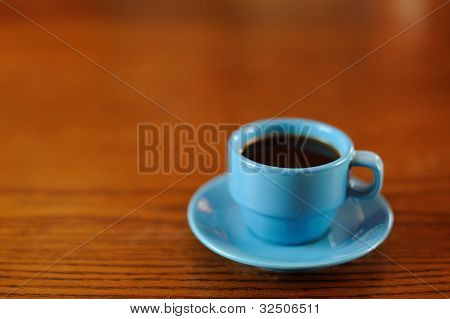 Blue Coffee Cup on Wooden Table