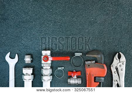 Repair Plumbing Background. Spanner And Fitting For Plumber. Copy Space.