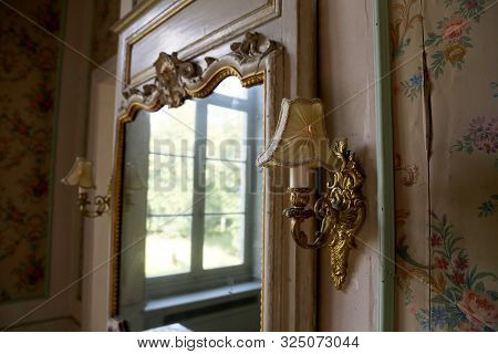 Beautiful Wooden Frame Mirror In Old Building Without People. Old Building Consisting Of Frame Mirro