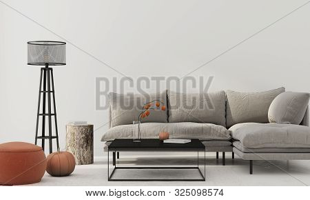 Living Room Interior With Gray Sofa, Terracotta Pouf, Stump, Black Metal Table, Floor Lamp And Pumpk