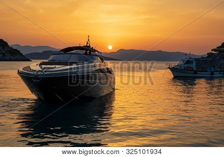 Summertime Luxury Yacht At Sunset As Seen From The Beach Of Aponissos, Agistri Island, Saronic Gulf,