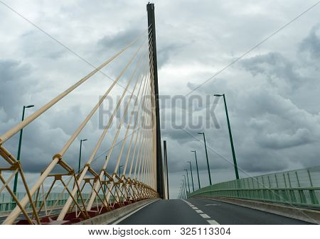 Modern Suspension Bridge Over The River Seine In Normandy In Northern France