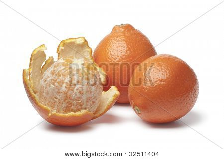 Whole and peeled Tangelo on white background