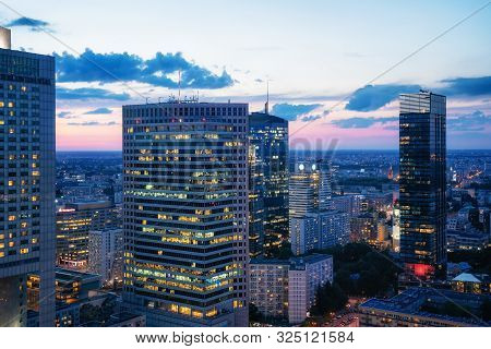 Aerial View Of Warsaw Downtown Business District At Night, Poland