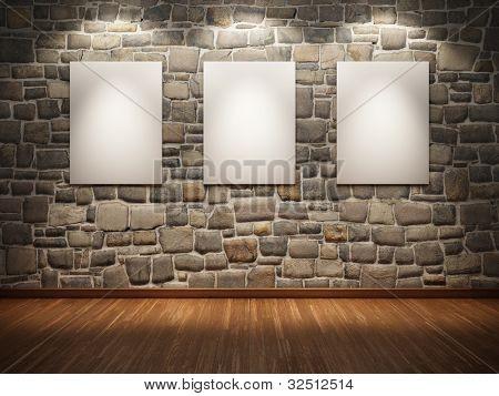 Blank frame on stone wall illuminated spotlights