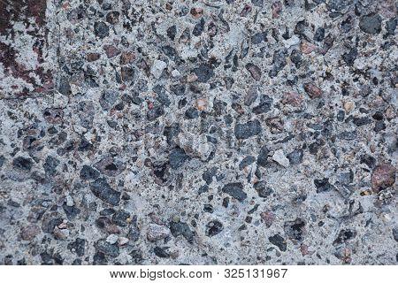 Gravel In Beton Pavement Surface. Close-up. Horizontal Image