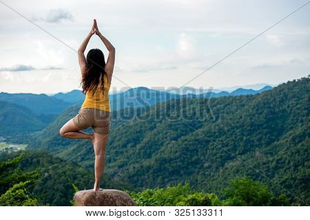 Woman Do Yoga Lifestyle Balance Practicing And Zen In Outdoor. Woman Exercising Vital And Meditation