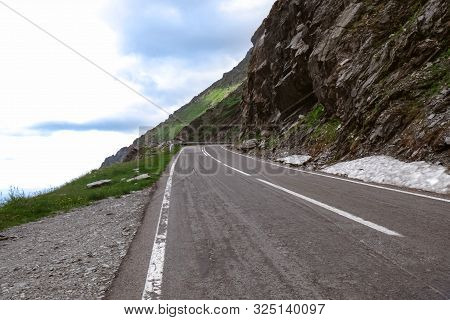 Beautiful View Of Road Along Crag On Cloudy Day