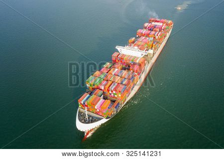 Aerial View Of The Large Volume Of Teu Container On Ship Sailing To The Sea Carriage The Shipment Fr