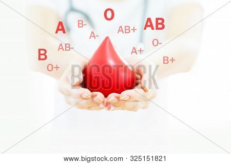 A Doctor Hands Holding A Red Blood
