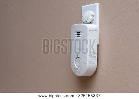 Carbon Monoxide (co) Monitor Plugged Into The Wall Of A Residential House For Safety.