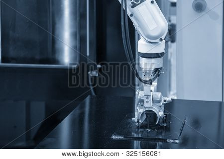 The Robotic Arm Handling The Aluminium Casting Parts To The Cleaning Process. The Ho Technology Auto