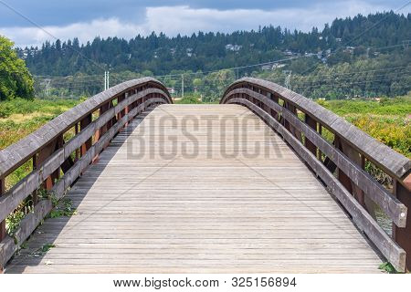 Foot Bridge For Pedestrians At Colony Farms, Coquitlam, British Columbia Canada On A Warm Sunny Day.
