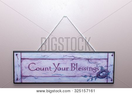 Count Your Blessings Sign Hangs On The Wall In A Home To Remember Thankfulness And Remembering Bless