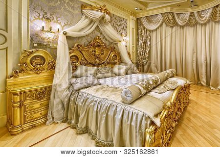 Luxurious Interiors In A Modern House. Stylish Bedroom Interior With Double Bed.