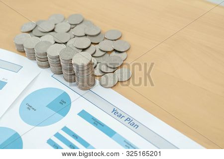 Coins Savings Chart Analyze On The Table