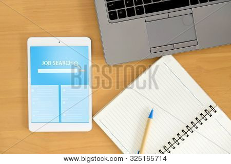 Top View Of Business Workspace To Job Search Engine, Notebook And Female Hands Typing On Keyboard