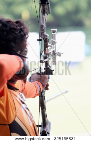 A Man Aiming At Target Sport Concept