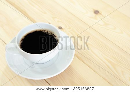 A Cup Coffee On The Wood Table