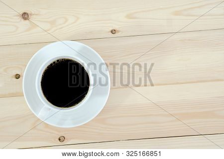 Cup Of Coffee On Weathered Dark Table
