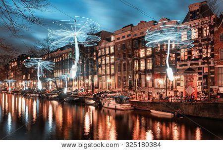 Amsterdam, Netherlands - January 14, 2019: Light Festival Amsterdam,  Wind Driven Propellers In Whit