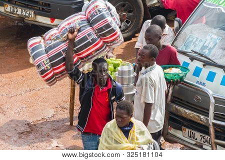 Kampala, Uganda - October 03, 2012.  A Man Carries A Mattress Above His Head At The Taxi Park In Kam