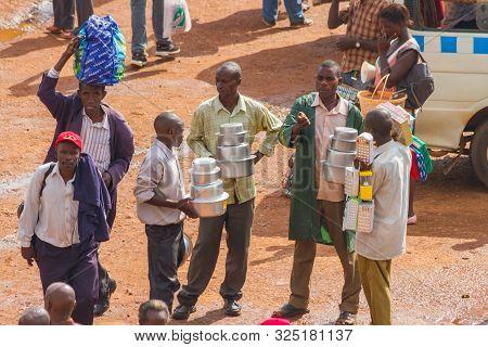 Kampala, Uganda - October 03, 2012.  Men Working In The Taxi Park In Kampala, Uganda On October 03,2